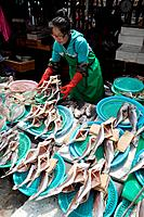 Busan (South Korea): a woman putting out fish to dry at the Sindonga-Jagalchi Market