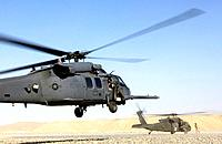 An HH-60 Pave Hawk helicopter lands as an Army UH-60 Blackhawk prepares to pick up a medivac patient June 13  The 33rd Expeditionary Rescue Squadron i...