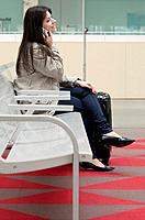 Teenage girl waiting in train station