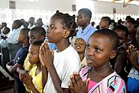 Children praying, Sunday mass at the Roman Catholic Parish of Buza, Dar es Salaam, Tanzania
