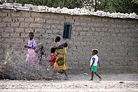 Children walking, some carrying sibling babies, village of Mwamalasa, Shinyanga, Tanzania