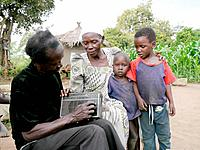 Family of former abductee of LRA listening to Radio Wa, Lira, Uganda