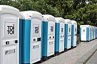 Portable toilets lined up in a row