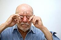 Man rubbing his eyes