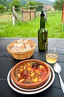 Pote asturiano serving and cider. Cabrales, Asturias province, Spain.