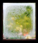 close up on wet, steamy window pane with wooden frame