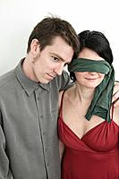Husband and his blindfolded wife