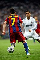David Villa trying to dribble past Cristiano Ronaldo, UEFA Champions League Semifinals game between Real Madrid and FC Barcelona, Bernabeu Stadiumn, M...