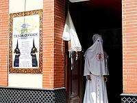 Cofrade shop in Seville selling robes and hats for Semana Santa processions  Andalusia, Spain