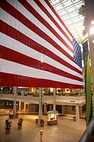 huge us american flag hanging in a shopping hickory hollow mall in Nashville Tennessee USA