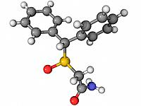 Modafinil, molecular model. This stimulant drug is used to treat narcolepsy. Atoms are represented as spheres and are colour_coded: carbon grey, hydro...