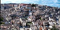 Aerial panorama of ancient town of Matera with tufa houses, sunny spring afternoon with blue sky, Puglia, Southern Italy,