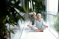 Mature couple sitting in a lotus position