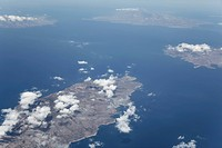 View above the clouds from airplane window, Santorini, Mediterranean Sea, Naxos, Paros, Greece, Europe