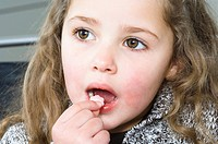Close_up of a girl eating a candy