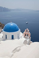 Blue Domed Church on City Hillside, Oia, Santorini, Cyclades Islands, Greece