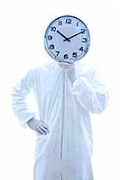 Man in biohazard suit holding clock in front of face standing against white background.