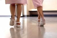 Female nurses walking in corridor quickly, blurred motion