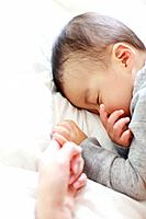 Mother Son Sleeping Lying On Side Holding Finger