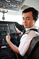 Pilot in private jet cockpit