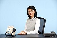 Smart Mid_Adult Woman Sitting at Desk