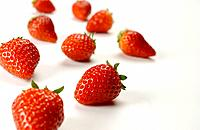 Strawberries on white background, close up