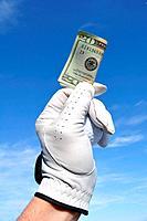 Golfer Wearing Golf Glove Holding a Twenty Dollar Bill