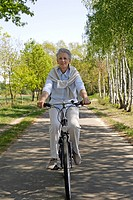 Older female person bicycling