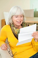 Elderly lady reading a letter