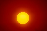 LARGE SUN ON CLEAR ORANGE SKY