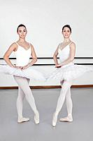 Ballet dancers posing together in studio