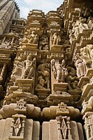Sculptures on the wall of a temple, Khajuraho, Chhatarpur District, Madhya Pradesh, India