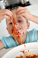 Close_up of a girl eating fettuccine
