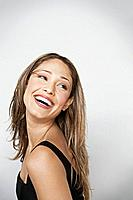 Studio portrait of smiling beautiful woman