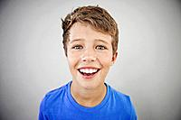 Portrait of smiling boy 13_15, studio shot