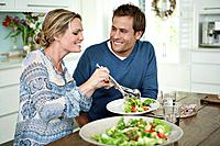 Smiling couple dining at table