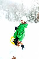 Girl sledging in snow (thumbnail)