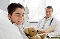 Portrait of male doctor with boy 7_9 patient in hospital