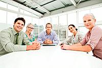 Five businesspeople meeting in office