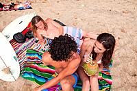 Three young friends on beach vacation (thumbnail)