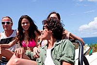 Three young friends in off road vehicle on vacation