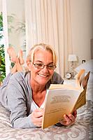 Mature woman reading a book (thumbnail)
