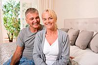 Mature couple in bedroom (thumbnail)