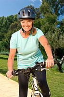 Mature woman cyclist wearing helmet