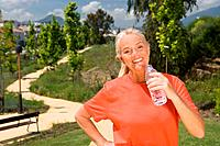 Mature woman runner with bottle of water