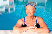 Mature woman in swimming pool (thumbnail)