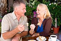 Mature couple having cake (thumbnail)