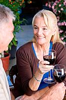 Mature couple having red wine (thumbnail)