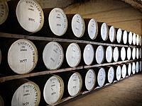 Barrels of whisky in distillery