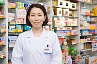 Pharmacist Standing in Front of Shelves